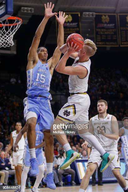 Rex Pflueger of the Notre Dame Fighting Irish shoots the ball against Garrison Brooks of the North Carolina Tar Heels at Purcell Pavilion on January...