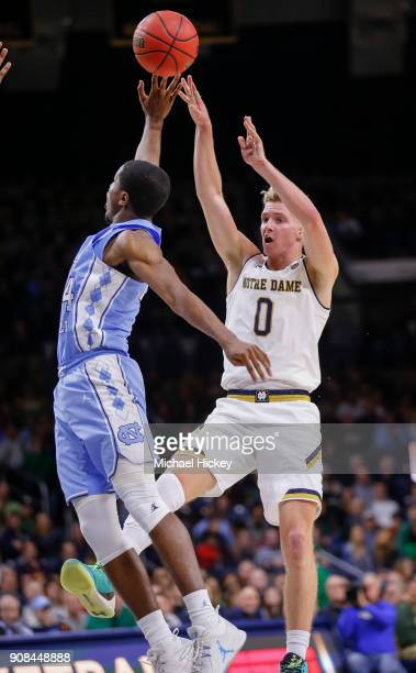 Rex Pflueger of the Notre Dame Fighting Irish shoots the ball against Kenny Williams of the North Carolina Tar Heels at Purcell Pavilion on January...