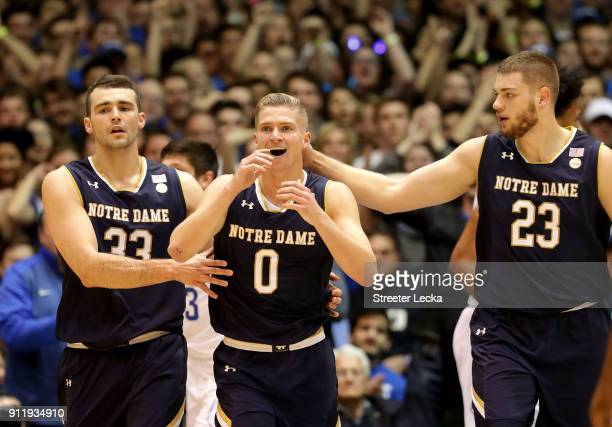 Rex Pflueger reacts after a play alongside teammates John Mooney and Martinas Geben of the Notre Dame Fighting Irish during their game at Cameron...