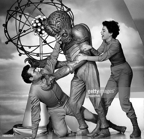 Rex Reason and Faith Domergue battle with a mutant alien in the film This Island Earth
