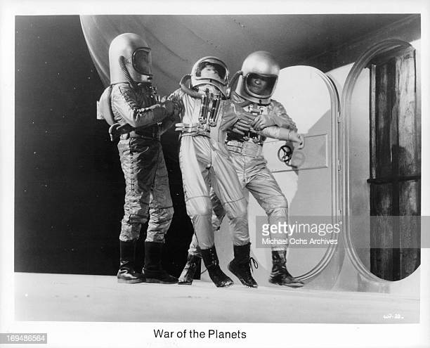 Rex Reason leads Faith Domergue along with Jeff Morrow in a scene from the film 'War Of The Planets' 1958