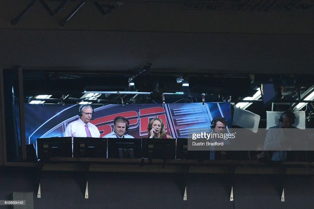 Rex Ryan (L) and Beth Mowins (C), the first woman in 30 years to call an NFL game on TV, in the ESPN broadcast booth during the game between the Denver Broncos and the Los Angeles Chargers at Sports Authority Field at Mile High on September 11, 2017 in Denver, Colorado.