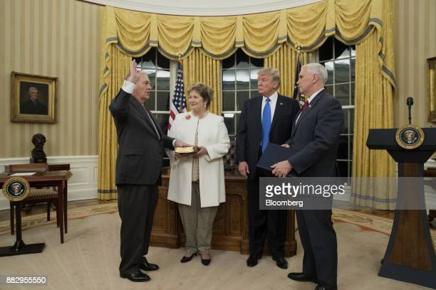 Rex Tillerson US Secretary of State left is sworn in by US Vice President Mike Pence right as US President Donald Trump second right and Renda St...