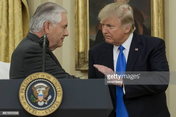 Rex Tillerson US Secretary of State left shakes hands with US President Donald Trump during a swearing in ceremony in the Oval Office of the White...