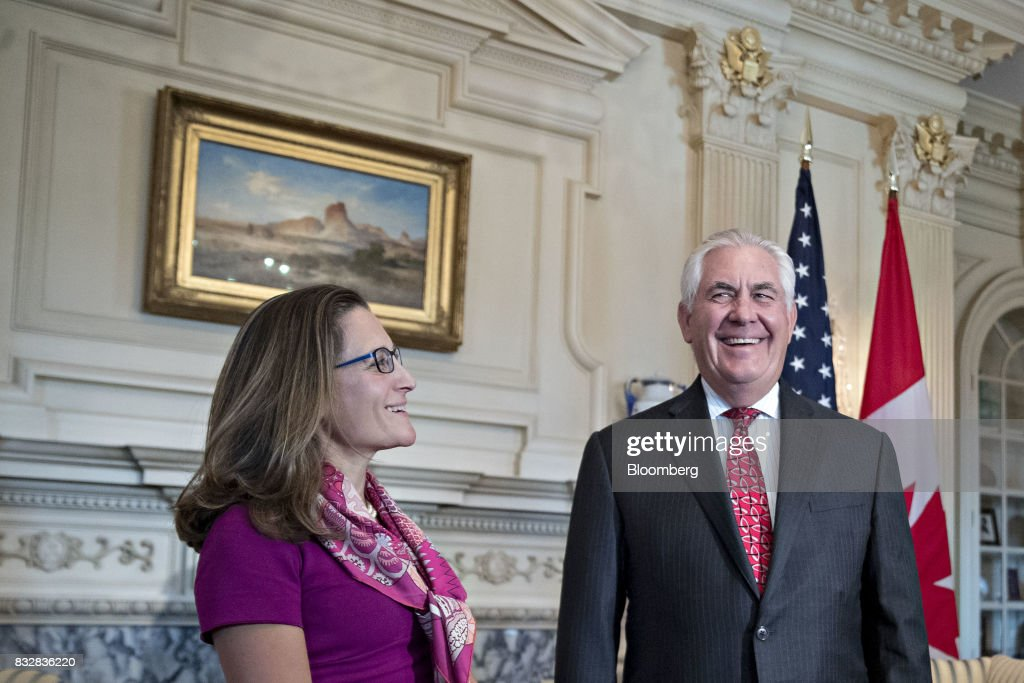 Rex Tillerson, U.S. secretary of State, right, and Chrystia Freeland, Canada's minister of foreign affairs, smile while meeting at the State Department in Washington, D.C., U.S., on Wednesday, Aug. 16, 2017. Starting today the first round of North American Free Trade Agreement (NAFTA) renegotiations began with Canada and Mexico largely wanting to defend the advantages they have enjoyed under the two-decade-old Nafta deal, keep it free of tariffs and broaden it to new industries. President Donald Trump has called Nafta the worst trade pact in history and promised to fix it through negotiations or withdraw. Photographer: Andrew Harrer/Bloomberg via Getty Images