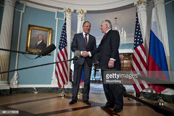 Rex Tillerson US Secretary of State right and Sergei Lavrov Russia's foreign minister shake hands during a photo opportunity at the US Department of...