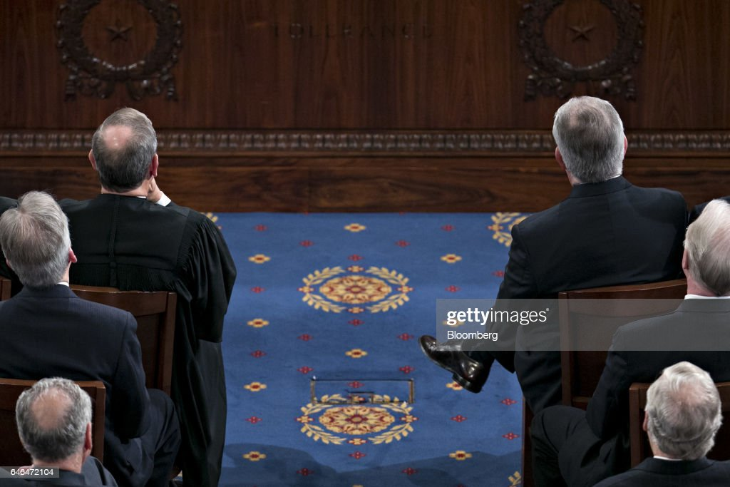 Rex Tillerson, U.S. secretary of State, right, and Supreme Court Chief Justice John Roberts listen as U.S. President Donald Trump, not pictured, speaks during a joint session of Congress in Washington, D.C., U.S., on Tuesday, Feb. 28, 2017. Trump will press Congress to carry out his priorities for replacing Obamacare, jump-starting the economy and bolstering the nations defenses in an address eagerly awaited by lawmakers, investors and the public who want greater clarity on his policy agenda. Photographer: Andrew Harrer/Bloomberg via Getty Images