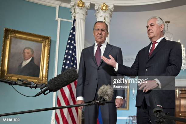 Rex Tillerson US Secretary of State right speaks as Sergei Lavrov Russia's foreign minister listens during a photo opportunity at the US Department...
