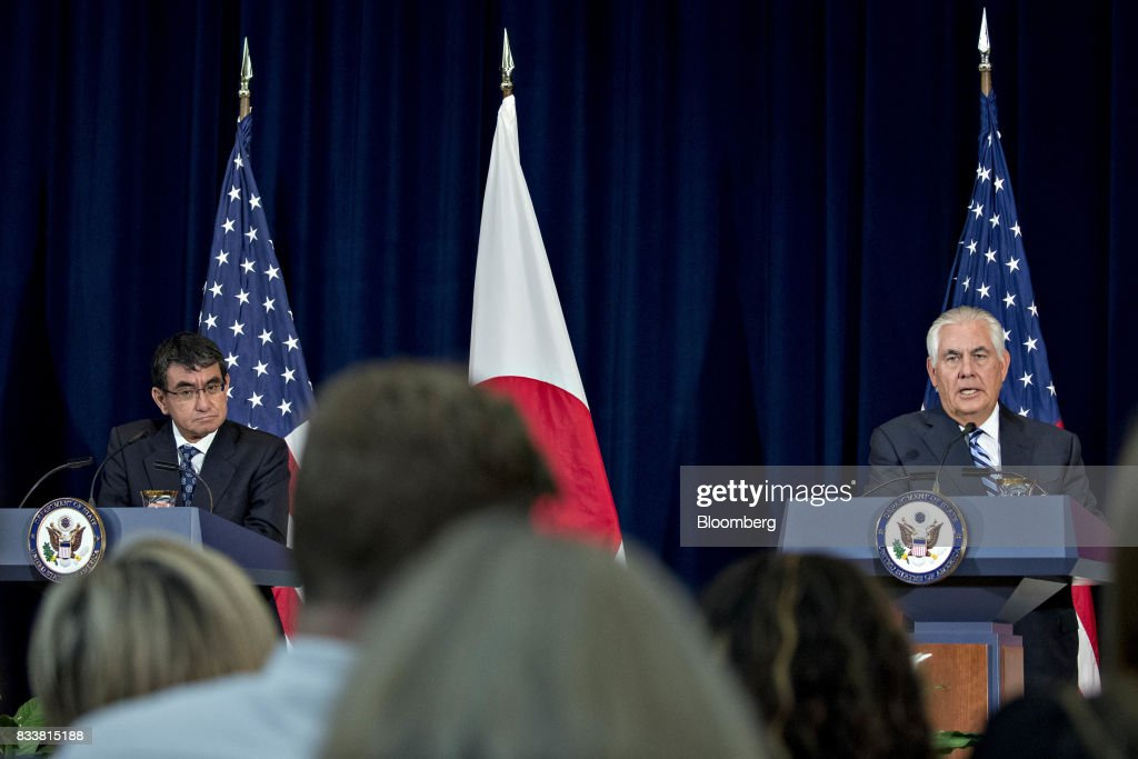 Rex Tillerson, U.S. secretary of State, right, speaks as Taro Kono, Japan's foreign minister, listens at a news conference during the Security Consultative Committee (2+2) meeting at the State Department in Washington, D.C., U.S., on Thursday, Aug. 17, 2017. The Japanese and U.S. defense and foreign ministers are meeting to discuss how to strengthen their missile defense capabilities following North Korea's firing of two intercontinental ballistic missiles in July. Photographer: Andrew Harrer/Bloomberg via Getty Images