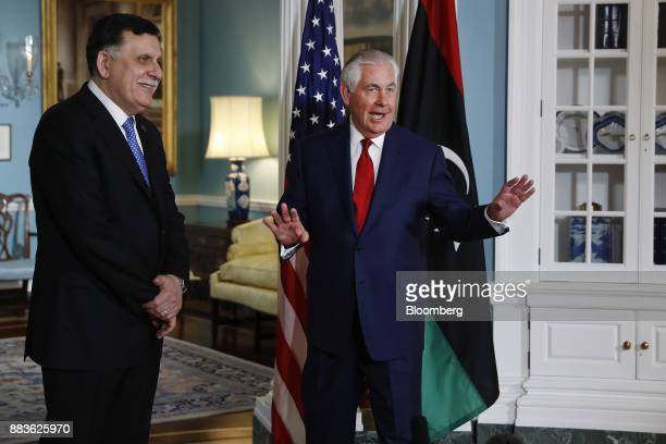 Rex Tillerson US Secretary of State right speaks to members of the media as Fayez alSarraj Libya's prime minister smiles before a meeting at the...