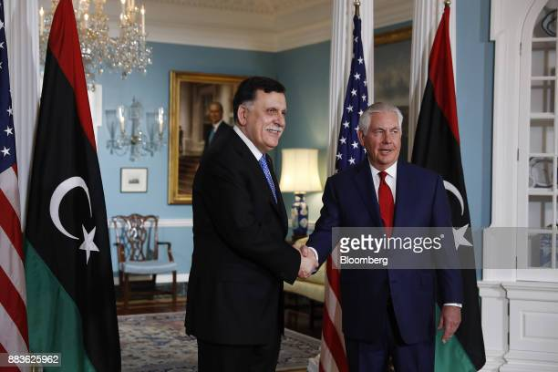 Rex Tillerson US Secretary of State shakes hands with Fayez alSarraj Libya's prime minister before a meeting at the State Department in Washington DC...
