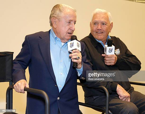Rex White newly inducted into the NASCAR Hall of Fame left jokes with fellow hall member Junior Johnson during NASCAR's Fan Appreciation Day at the...