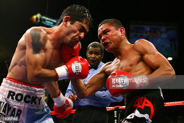 Rey Bautista of the Philippines connects with a right to the face of Sergio Medina of Argentina during their WBO junior featherweight title...