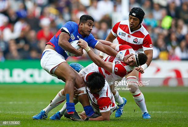 Rey LeeLo of Samoa hands off Luke Thompson of Japan during the 2015 Rugby World Cup Pool B match between Samoa and Japan at Stadium mk on October 3...