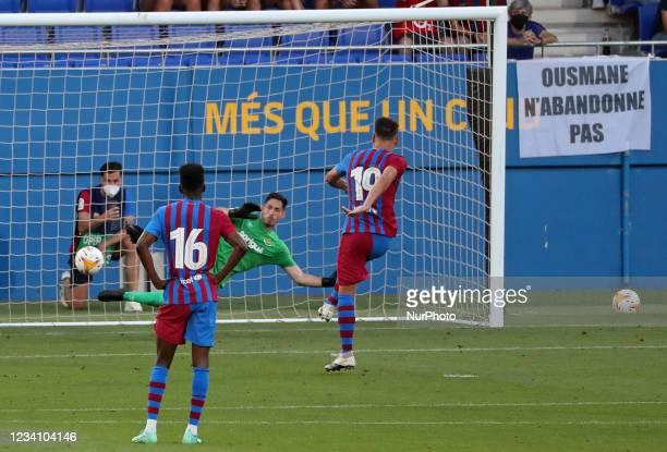 Rey Manaj scores a penalty during the friendly match between FC Barcelona and Club Gimnastic de Tarragona, played at the Johan Cruyff Stadium on 21th...