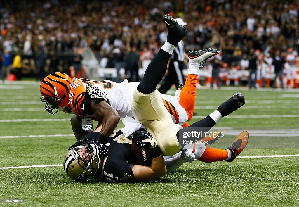 Rey Maualuga #58 of the Cincinnati Bengals and Shawn Williams #36 of the Cincinnati Bengals stop a fourth down conversion by Erik Lorig #41 of the New Orleans Saints during the first quarter against the New Orleans Saints at Mercedes-Benz Superdome on November 16, 2014 in New Orleans, Louisiana.