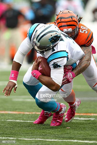 Rey Maualuga of the Cincinnati Bengals tackles Cam Newton of the Carolina Panthers during the second quarter at Paul Brown Stadium on October 12 2014...