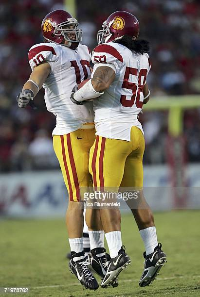 Rey Maualuga of the USC Trojans and Brian Cushing celebrate after Maualuga made a second quarter interception against the Arizona Wildcats during the...