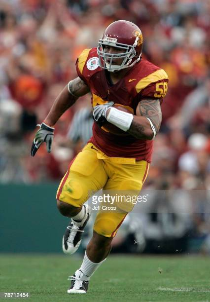 Rey Maualuga of the USC Trojans returns an interception against the Illinois Fighting Illini in the first quarter during the Rose Bowl presented by...