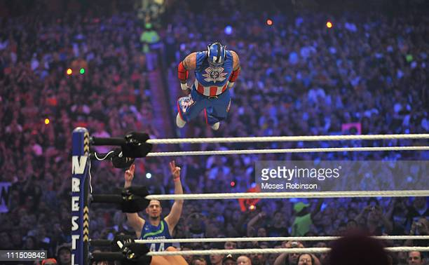 Rey Mysterio and Cody Rhodes battle during their WWE match at 'WrestleMania 27' at the Georgia World Congress Center on April 3 2011 in Atlanta...