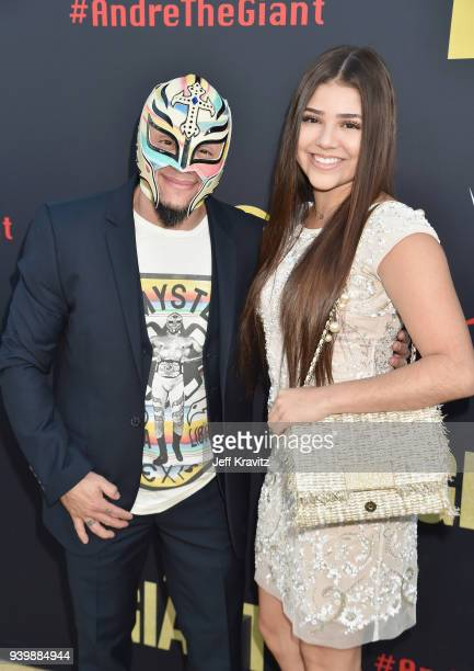 Rey Mysterio and guest attend the Los Angeles Premiere of Andre The Giant from HBO Documentaries on March 29 2018 in Los Angeles California