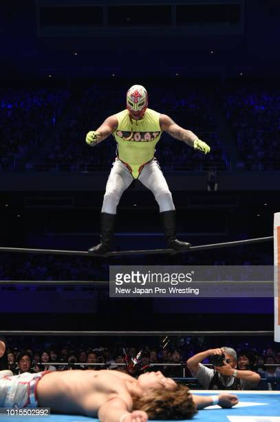 Rey Mysterio Jr dives on Yoh to win by a fall in the the 6man tag match during the New Japan ProWrestling G1 Climax 28 at Nippon Budokan on August 12...
