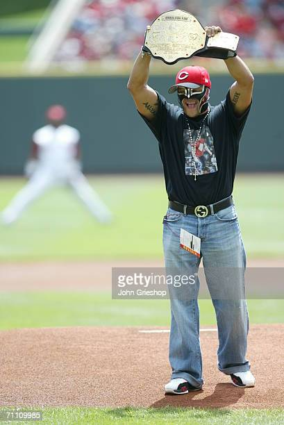 Rey Mysterio of the WWE holds up a belt prior to the game between the Cincinnati Reds and the St Louis Cardinals at Great American Ball Park in...