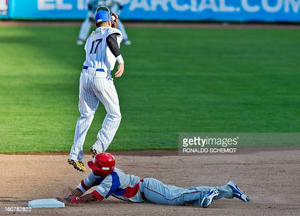 Rey Navarro of Criollos de Caguas of Puerto Rico slides safe in second base in a match against Magallanes of Venezuela during the 2013 Caribbean...