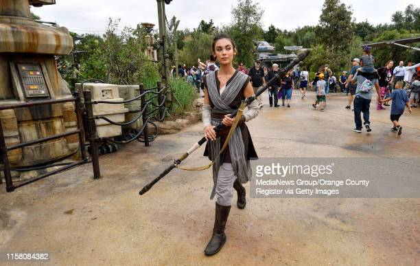 Rey walks around the Resistance side of Black Spire Outpost during the first day without needing a reservation at Star Wars Galaxyu2019s Edge inside...