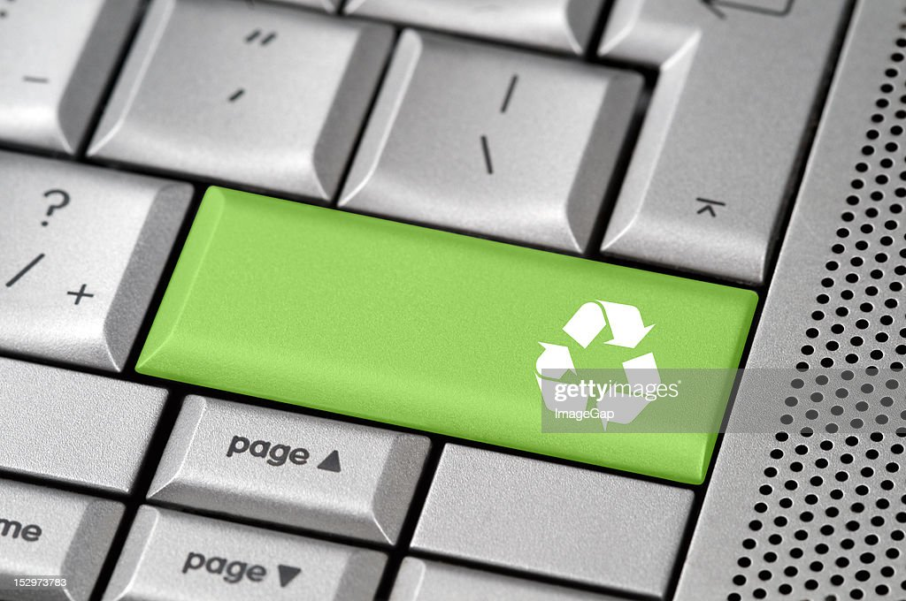 Reycle button concept on a laptop keyboard : Stock Photo