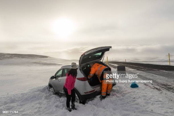 Reydarfjordur,Iceland - March 07,2018 : Car Accident ,Tourist car slipped out of the road and stuck in snow