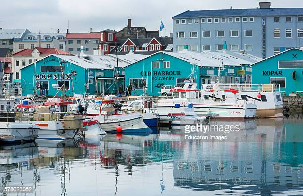 Reykjavik Iceland Arctic downtown Harbor marina colorful small fishing boats and reflections in water at port
