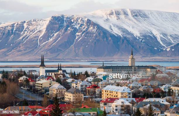 reykjavik the capital cities of iceland during the end of winter season. - reykjavik stock pictures, royalty-free photos & images