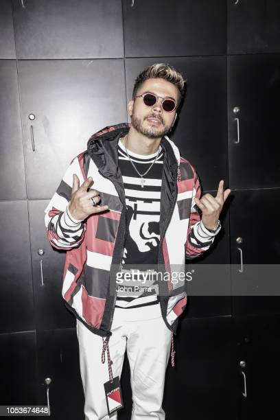 Reykon attends The Enrique Santos Show At I Heart Latino Studios at I Heart Latino Studios on October 25 2018 in Miramar Florida