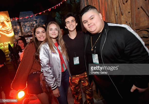 Reylynn Caster Jack Dylan Grazer and Jovan Armand attend the Warner Bros Studio Tour Hollywood Horror Made Here A Festival Of Frights on October 3...