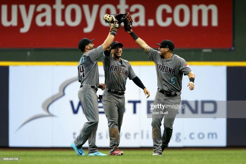 Reymond Fuentes #14, Gregor Blanco #5, and David Peralta #6 of the Arizona Diamondbacks celebrate after beating the Milwaukee Brewers 4-0 at Miller Park on May 25, 2017 in Milwaukee, Wisconsin.