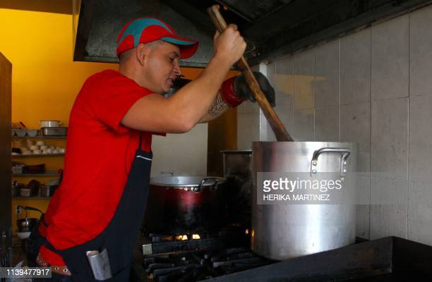 Reynel Perez from Holguin Cuba works as a cook at the Little Havana restaurant while waiting for his turn to cross to the United States to request...