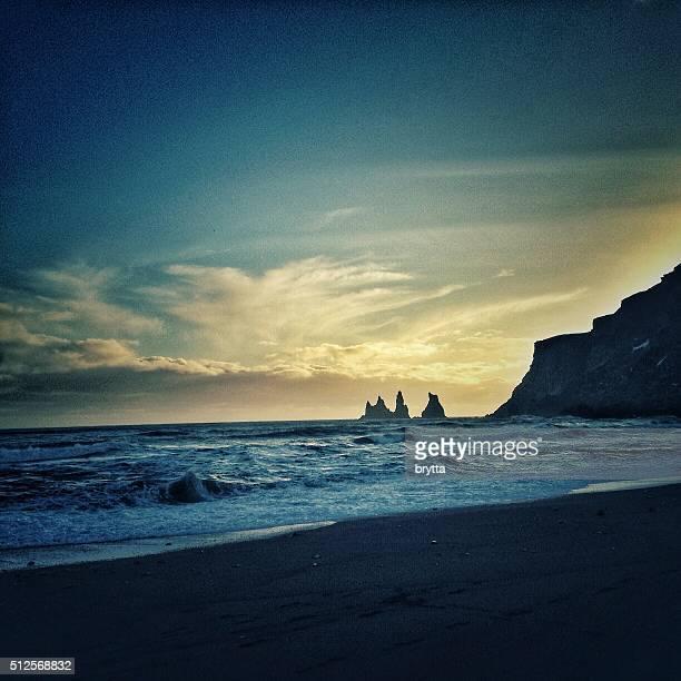 Reynisdrangar basalt sea stacks at sunset in Vik,Iceland
