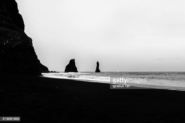 reynisdrangar basalt sea stacks - ignatius tan stock photos and pictures