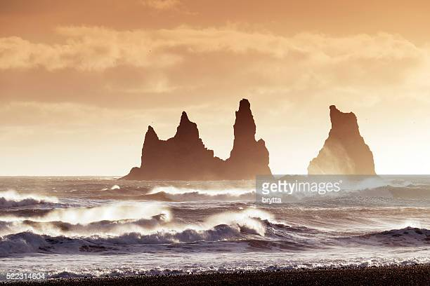 Reynisdrangar sea stacks in  Atlantic Ocean at sunset,Vik,Iceland