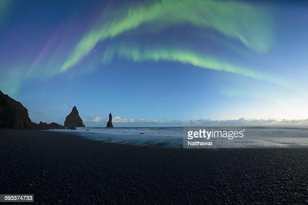Reynisdrangar sea stacks with Aurora Iceland