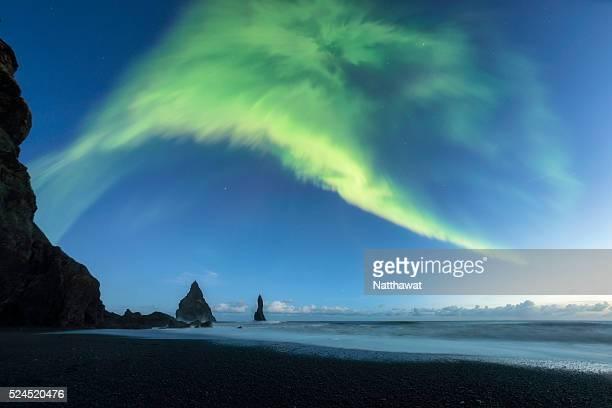 Reynisdrangar sea stacks with Aurora Vik Iceland