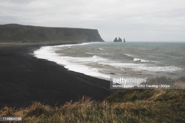reynisfjara black sand beach - punalu'u_beach stock pictures, royalty-free photos & images