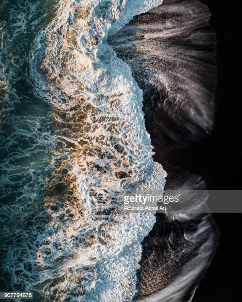 reynisfjara black sand beach - water's edge stock pictures, royalty-free photos & images