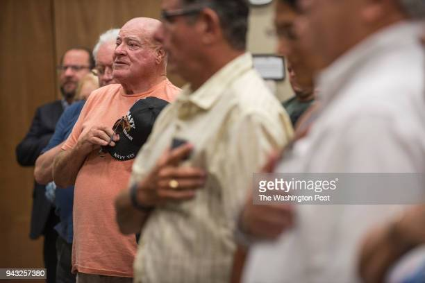 APRIL 4 2018 Reynold Bassett recites the Pledge of Allegiance during a town hall meeting with US Rep Brian Mast hosted by Concerned Veterans for...