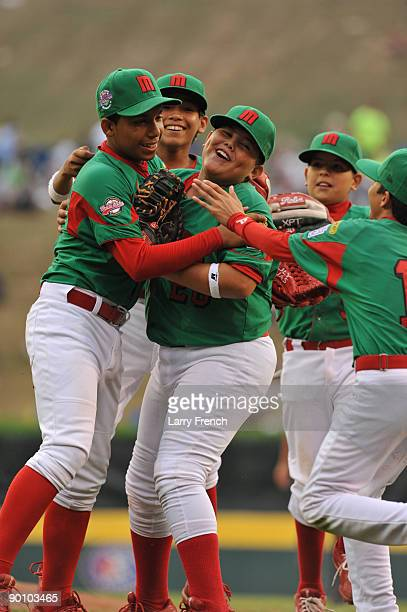 Reynosa Mexico players celebrate their victory against Chiba City Japan during the international semifinal at Lamade Stadium on August 26 2009 in...