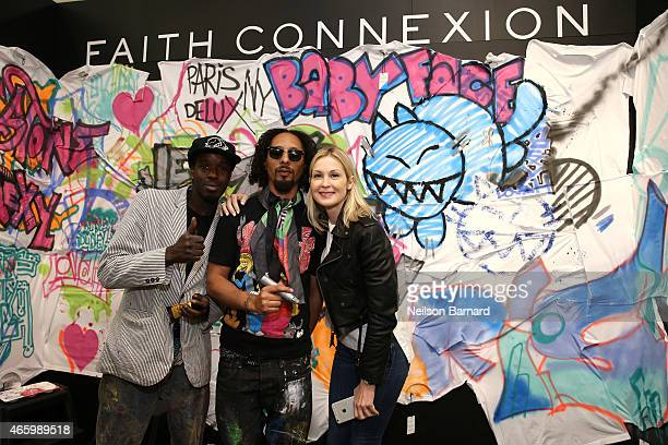 Reyz Le H and actress Kelly Rutherford attend the Faith Connexion Street Art Tour hosted by Saks Fifth Avenue and Marie Claire at Saks Fifth Avenue...