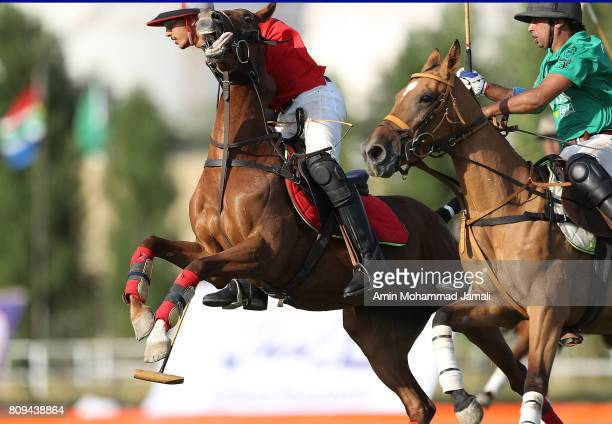 Reza Behboudi of Iran and Agha Mousa Alikhan of Pakistan in action during World Polo Championship 2017 Qualifiers on July 5 2017 in Tehran Iran