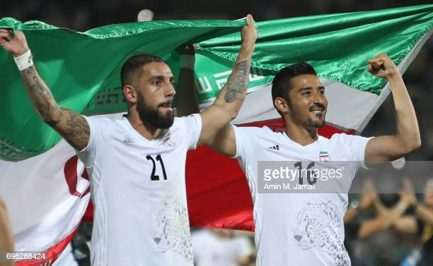 Reza Ghochannejad and Ashkan Dejagah of Iran celebrate after the match during FIFA 2018 World Cup Qualifier match between Iran and Uzbekistan at...