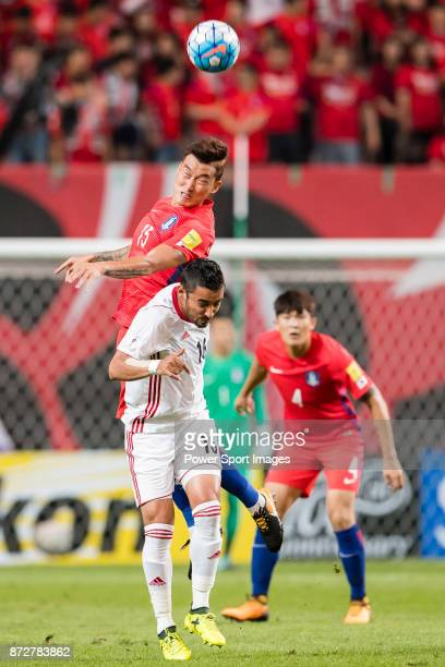Reza Ghoochannejad of Iran fights for the ball with Jang Hyunsoo of Korea Republic during their 2018 FIFA World Cup Russia Final Qualification Round...
